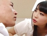 Appealing Japanese AV model seduces a cute bald guy gives a foot job picture 12