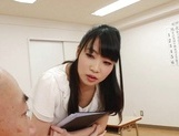 Appealing Japanese AV model seduces a cute bald guy gives a foot job picture 13