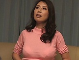 Mature Asian temptress gives satisfying head picture 11