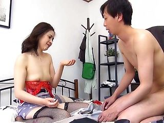 Attractive Asian babe strips and sucks dick