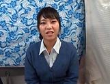 Pretty Asian babe smiles as she sucks a cock