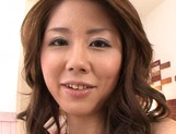 Hot sexy milf Uduki Manami gives a handjob to her lover