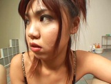 Appetizing Japanese teen doll shows off with a hot titfuck