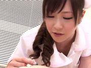 Asian nurse with curly hair Arisa Nakano makes cock massage