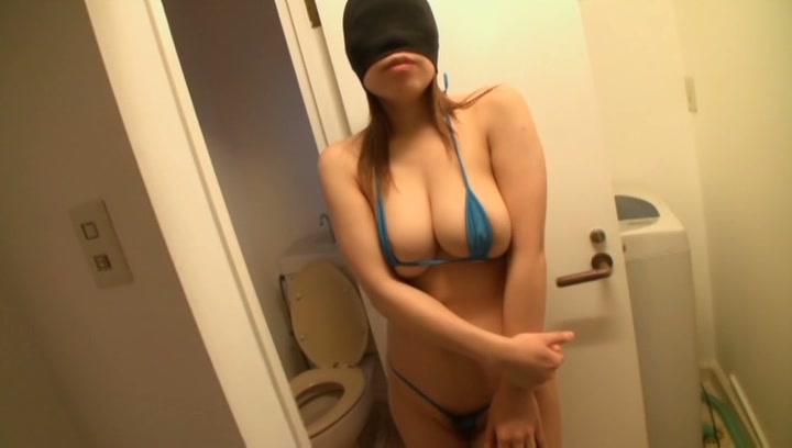 Hot busty Japanese AV model in a bikini masturbates