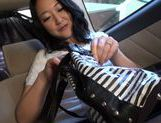 Japanese MILF cums from a vibrator and gives head in a car picture 11