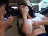 Japanese MILF cums from a vibrator and gives head in a car picture 14