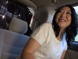 Japanese MILF cums from a vibrator and gives head in a car