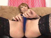 MILF Aya Kisaki dresses up to fuck herself with a dildo