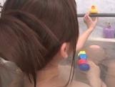 Petite Japanese milf Yui Hatano licks feet and sucks cock in a bathroom