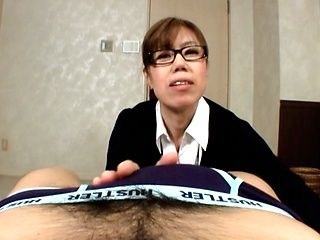 Mature Japanese AV Model is a busty babe stroking cock