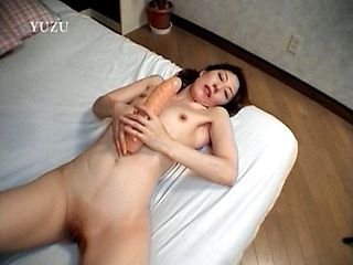 Solo girl action with Madoka Enomoto stuffing herself with dildo