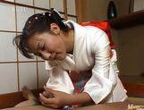 Kimono clad Japanese MILF Megumi Tsuchida wanks off a dick picture 11