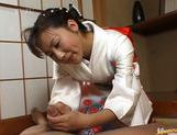 Kimono clad Japanese MILF Megumi Tsuchida wanks off a dick picture 13