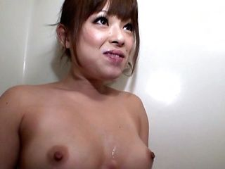 Busty chick sits in the tub giving a messy blowjob