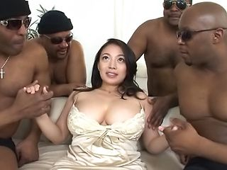 Busty Asian milf gets fucked hard in gangbang