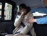 Hot Japanese teen featured in a car sex scene picture 14