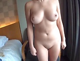 Beautiful Asian babe in a raunchy solo tease action