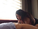 Busty Japanese AV model gets titfucked and enjoys a cock ride picture 15