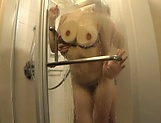 Charming Japanese milf Rinne Touka gives head in the shower picture 11