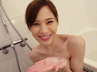 Skinny Asian MILF with perky tits Kamizaki Mai gives a blowjob in the shower