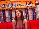 Milf in a mini bikini gives a handjob
