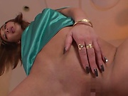 Aika is a sensual milf with shaved pussy